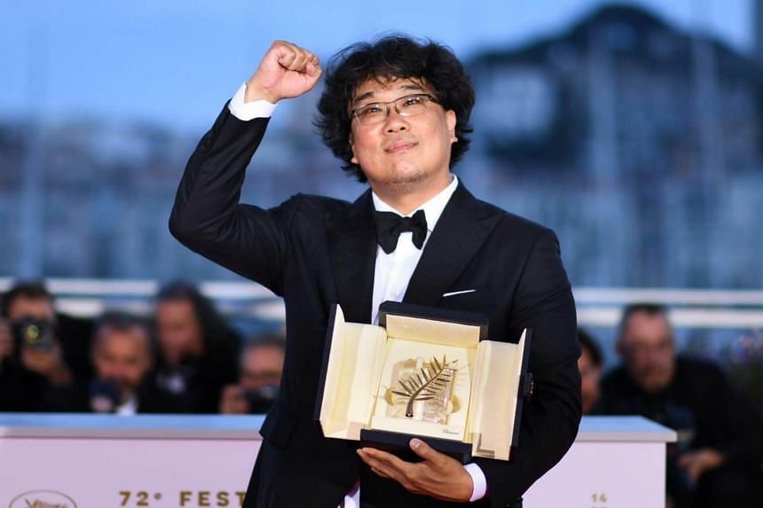 South Korean director Bong Joon-Ho celebrates after winning the Palme d'Or for the film Parasite (Gisaengchung) on May 25, 2019, during the closing ceremony of the 72nd edition of the Cannes Film Festival.