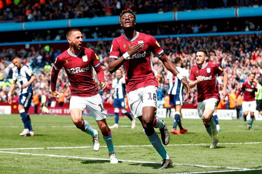 Aston Villa's Tammy Abraham celebrates scoring his second goal with team mates during their Championship Play-Off Semi Final First Leg match against West Bromwich at Villa Park, on May 11, 2019.