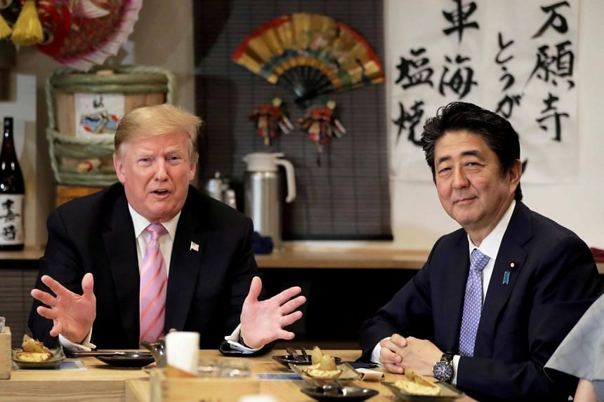 US President Donald Trump talks with Japanese Prime Minister Shinzo Abe during a couples dinner with first lady Melania Trump and Abe's wife Akie in Tokyo, Japan, on May 26, 2019.