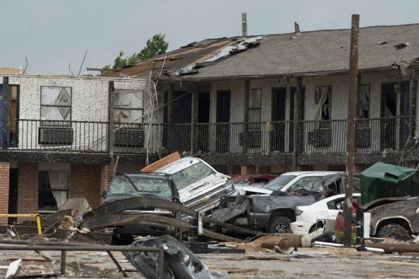 Guests' cars sit mangled outside the American Budget Value Inn on May 26, 2019 in El Reno, Oklahoma.
