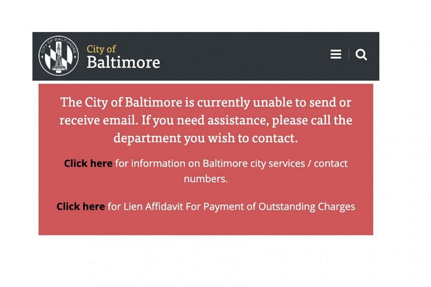 A notice on Baltimore city workers' computers in the ransomware attack, which has disrupted real estate sales, health alerts and other services.