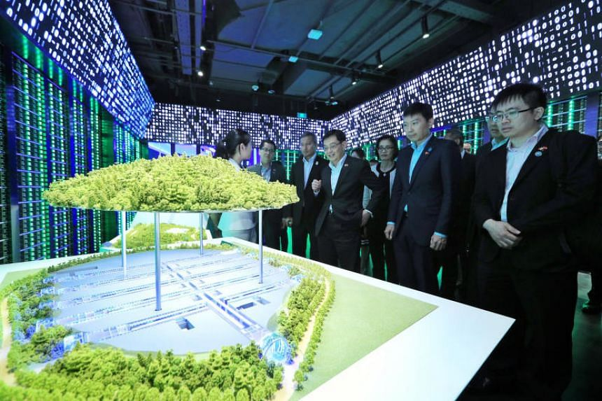 Deputy Prime Minister Heng Swee Keat (centre) viewing a model of Tencent's data centre in Guizhou during a tour of the Chinese technology giant's headquarters in Shenzhen, on Monday (May 27). With him are (from right) Senior Minister of State for