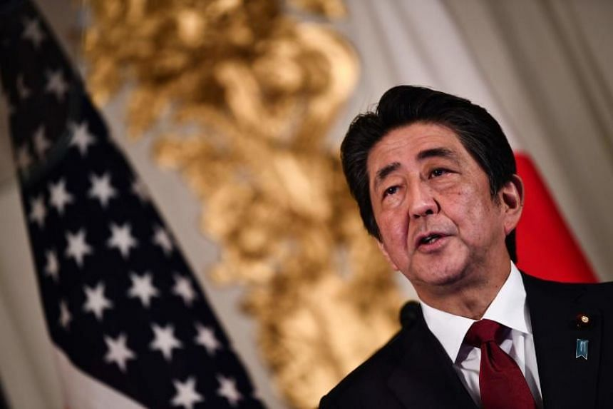 Japan's Prime Minister Shinzo Abe speaks during a joint press conference with at Akasaka Palace in Tokyo on May 27, 2019.