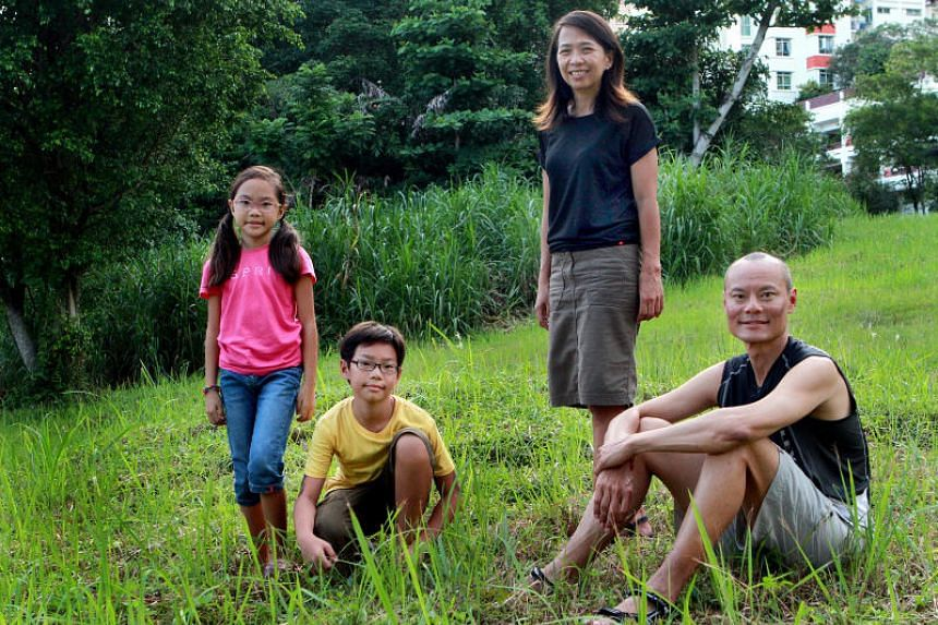 Singaporean adventurer and mountaineer Khoo Swee Chiow, with his family. He is the first South-east Asian to scale the world's three highest peaks.