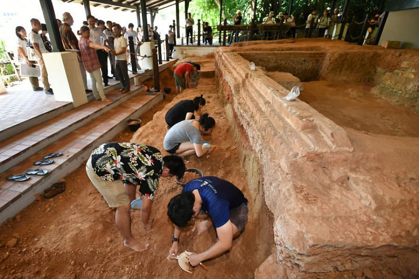 National University of Singapore and Nanyang Technological University students conducting archeological works at the Artisan's Garden at Fort Canning Park.