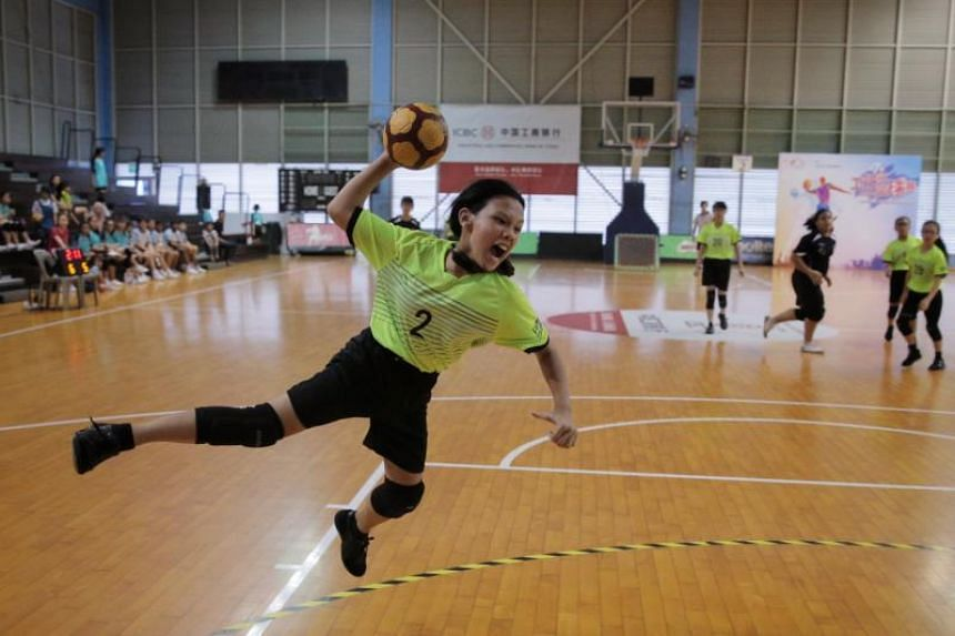 Farrer Park Primary School's Nur E'lyshah Binte Iswandi attempts a shot at the eighth edition of the SPH Foundation Tchoukball National Primary School Championships at the Singapore Basketball Centre on May 27, 2019.