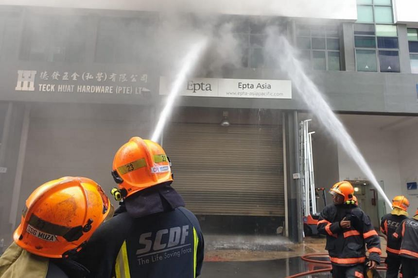 The fire was raging at the second floor of an industrial unit when Singapore Civil Defence Force officers arrived at the scene.