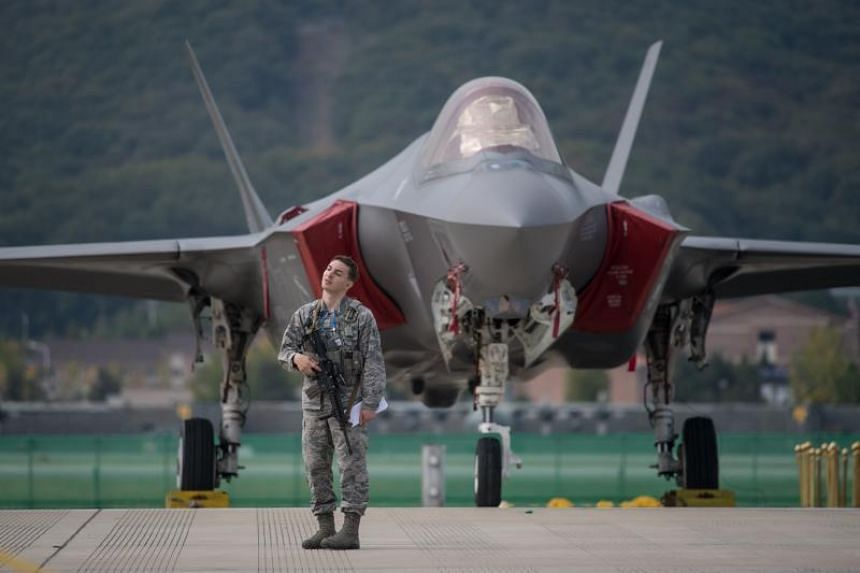 A US soldier guards a US F-35 stealth aircraft at the Seoul International Aerospace and Defence Exhibition in Seoul on Oct 16, 2017.