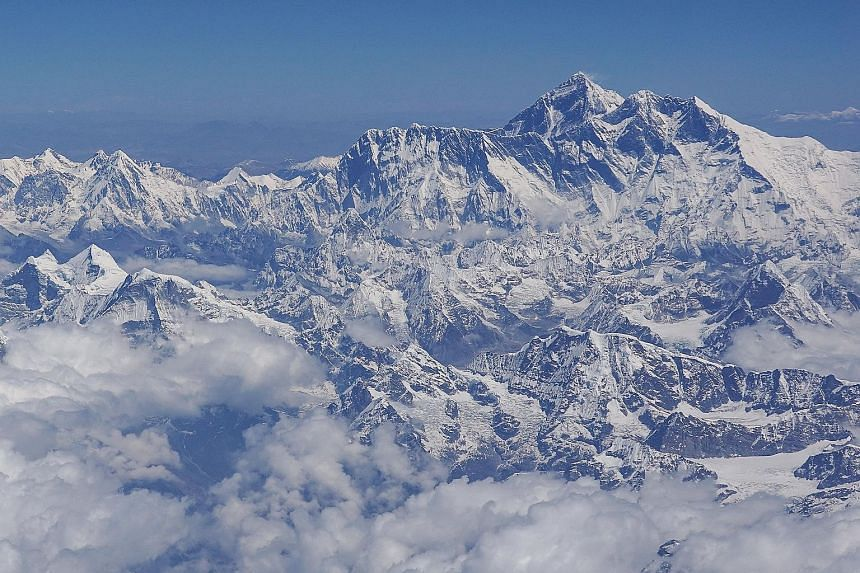 Climbers descend from the summit of Everest down the Hillary Step and across the cornice traverse to the South Summit. This has been one of the deadliest climbing seasons on Everest, with at least 10 dead or missing. Veteran climbers and industry lea