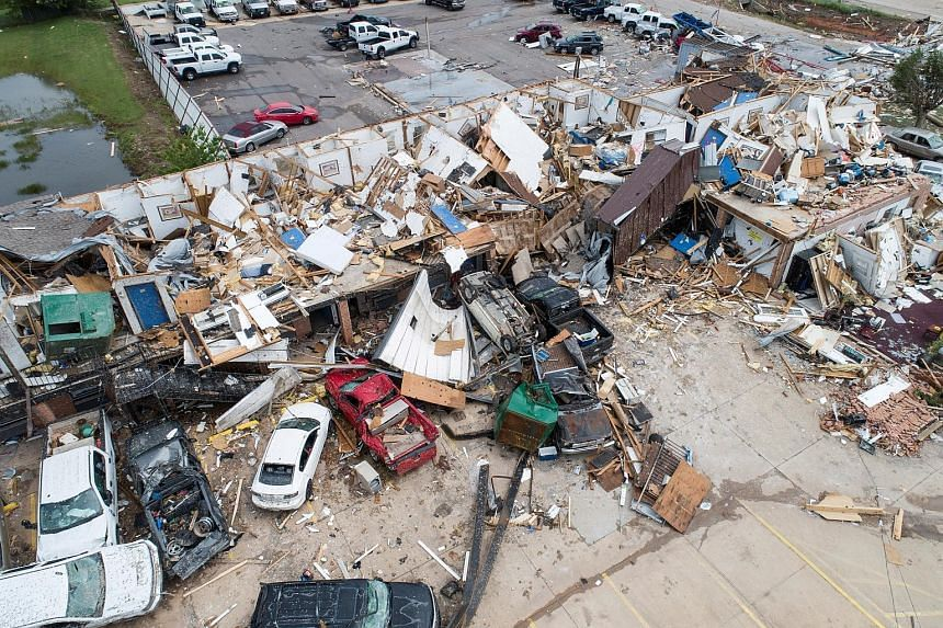 Little is left of the American Budget Value Inn after a tornado touched down overnight in El Reno, Oklahoma, on Sunday. At least six people were killed over the weekend in storms and hundreds left homeless.
