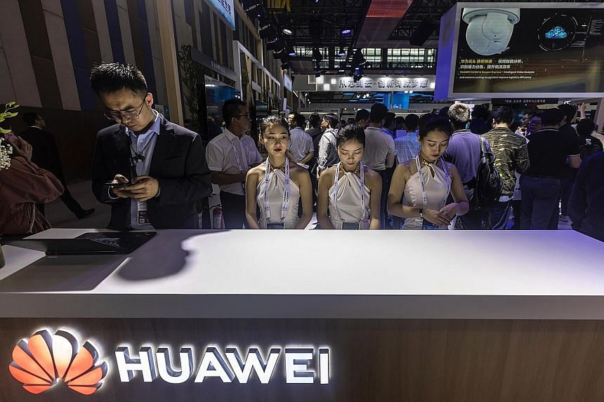 Huawei staff at an expo in Guiyang, China's Guizhou province, on Sunday. The country is in a separate digital universe to much of the rest of the world, and by cutting off Huawei, the US has taken a step that points towards a near-total tech split, s