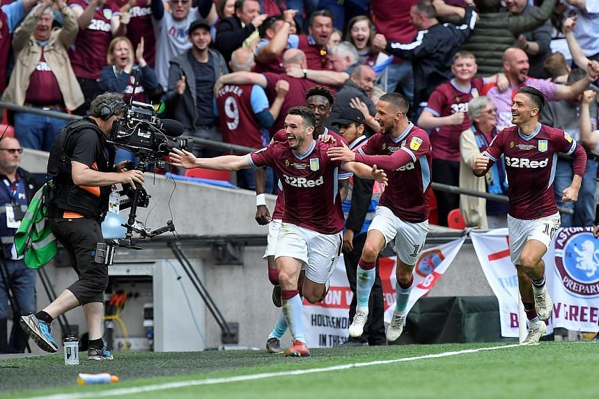 Aston Villa's John McGinn celebrates scoring their second goal that proved to be the difference in the Championship play-off final against Derby.