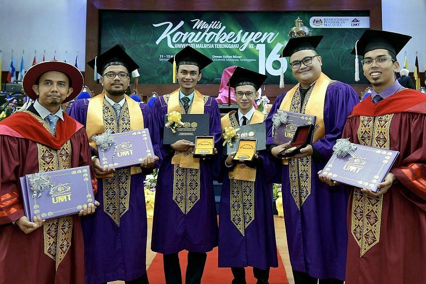 Graduates of Universiti Malaysia Terengganu at their convocation ceremony last November. Real starting monthly salaries for most fresh graduates have declined since 2010, says Bank Negara Malaysia. PHOTO: BERNAMA