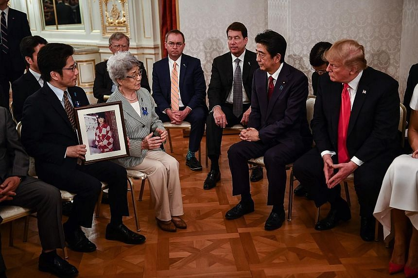 US President Donald Trump and Japanese Prime Minister Shinzo Abe meeting relatives of Japanese citizens who had been abducted by North Korean agents. Mr Abe has sought the support of world leaders including Mr Trump to raise the issue at their summit