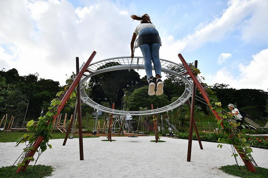 This green space at the foot of Fort Canning Hill has been restored as a family-friendly spot where children can play on swings, see-saws, logs and slides hugging the hill slope. ST PHOTO: LIM YAOHUI