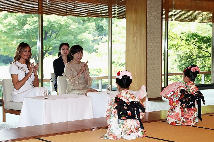 US President Donald Trump and Japan's Emperor Naruhito at a welcome ceremony at the Imperial Palace in Tokyo yesterday. At the imperial banquet, the Emperor spoke about his sense of nostalgia and closeness with the US. PHOTO: BLOOMBERG US First Lady