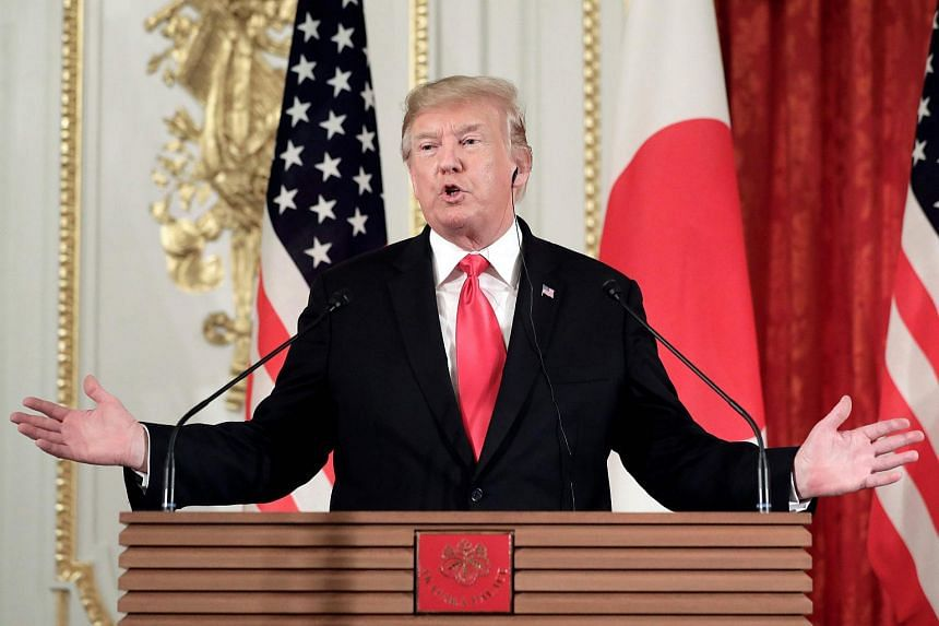 """US President Donald Trump said he expected Japan and the US to be """"announcing some things, probably in August, that will be very good for both countries"""" on trade."""