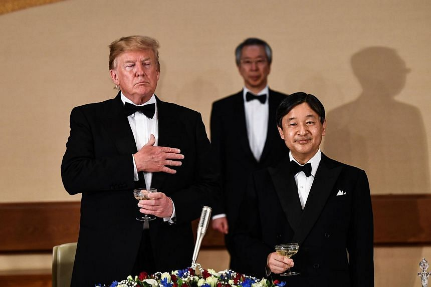 US President Donald Trump and Japan's Emperor Naruhito attend a state banquet at the Imperial Palace in Tokyo on May 27, 2019.
