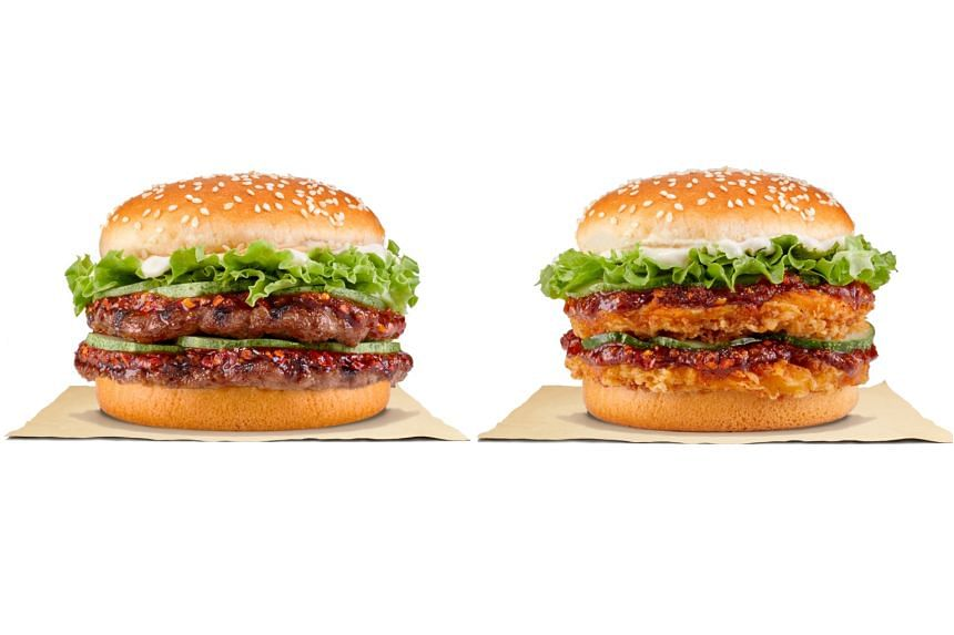 Burger King's Mala Beef Stacker burger (left) comprises two beef patties, while the Mala Chick'N Crisp Stacker burger includes two chicken patties, along with mayonnaise, crispy lettuce, sliced cucumbers, finished with mala sauce.