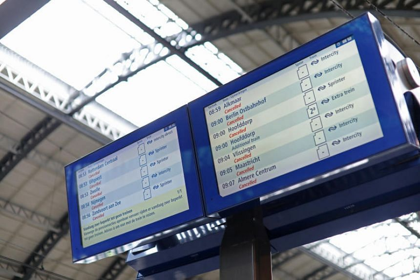 Cancelled destinations are seen on a screen at the departure train platform at Amsterdam Railway Station during a national public transport strike in Amsterdam, the Netherlands, on May 28, 2019.