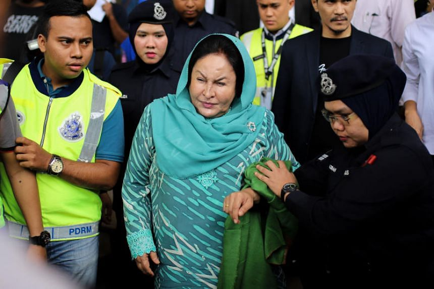 If convicted, Rosmah Mansor (centre) faces up to 20 years' imprisonment and a fine of no less than five times the amount of gratification.