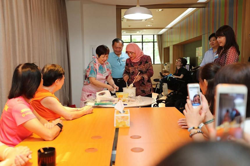 President Halimah Yacob engaging with family caregivers at a baking class in Abilities Beyond Limitations and Expectations.