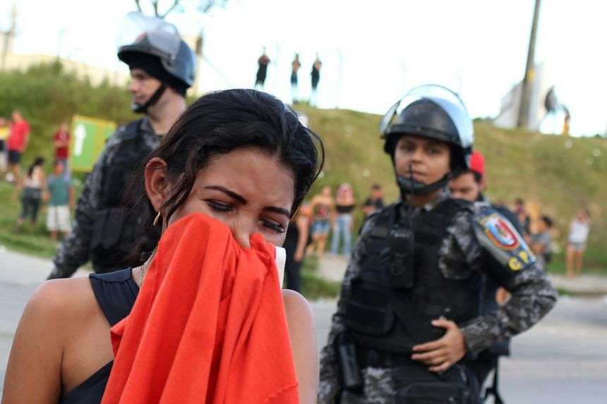 A relative of an inmate reacts in front of a prison complex in Manaus, Brazil, after prisoners were found strangled to death in four separate jails, on May 27, 2019.