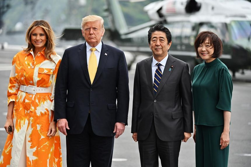 (From left) US First Lady Melania Trump, US President Donald Trump, Japanese Prime Minister Shinzo Abe and his wife Akie Abe on the deck during a visit to the Japanese Navy destroyer J.S Kaga (DDH-184), in Yokosuka, Japan, on May 28, 2019.