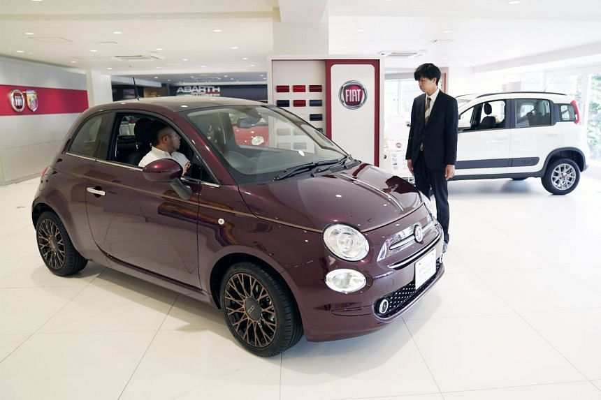 A Fiat Chrysler Automobiles' (FCA) Fiat 500 on display at a dealership in Tokyo. French group Renault said it was studying the proposal from the Italian-American FCA with interest, and considered it friendly. A deal could help both companies address