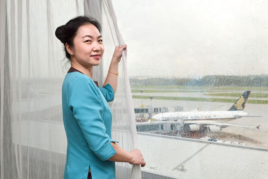 Room assistant Yuan Ai Hong by one of the hotel room windows in Crowne Plaza Changi Airport that have sensors that alert security if the windows are being tampered with. Earlier this month, the hotel became the first in Singapore to take part in Exer