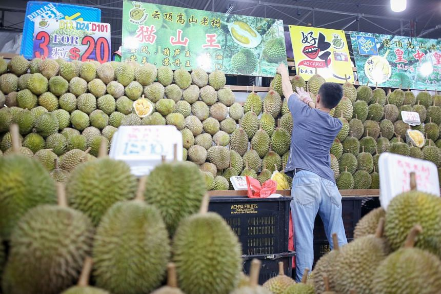 Mao Shan Wang durians are now going for about $18 a kilogram, down from the usual price of $28, following an increase in supply from Malaysia. ST FILE PHOTO