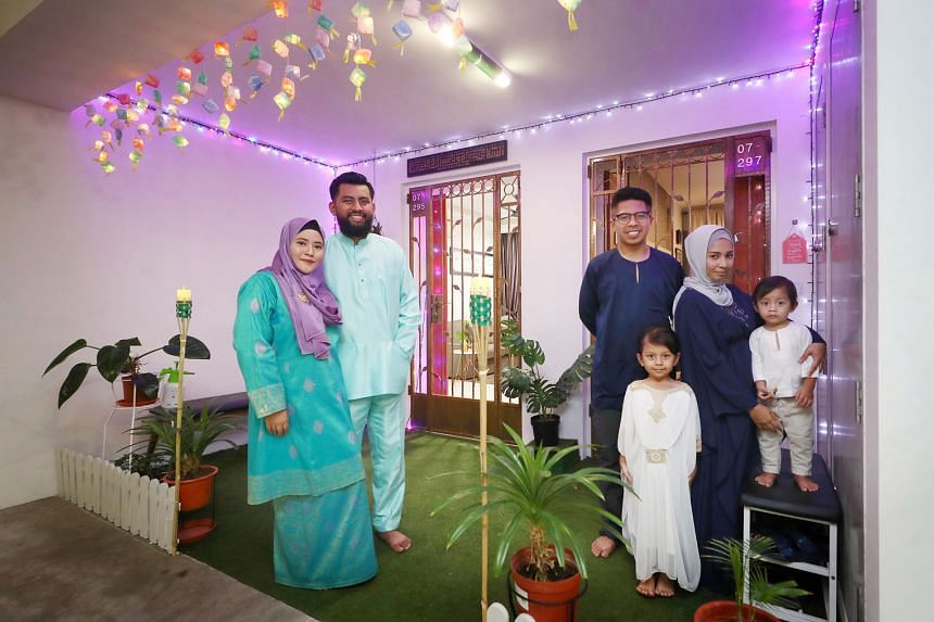 (From left) Ms Siti Zulaifa Sukardi and her husband Shaieful Azan Zanal Abidin with their next-door neighbours, Mr Muhammad Sabri Johari, his wife Siti Juliana Saptu and their two children Ifra Nur Dayana and Luth Aldriq at the kampung-themed shared