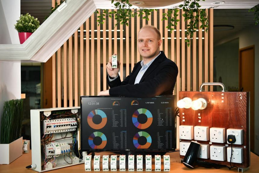 Mr William Temple, 31, Ampotech chief executive officer, with the AmpoHub device, at his lab space on May 28, 2019.