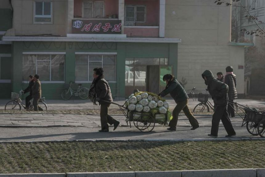 Officials across North Korea extort money from a population struggling to make ends meet, threatening them with detention and prosecution - particularly those working in the informal economy, the United Nations human rights office said in a report.