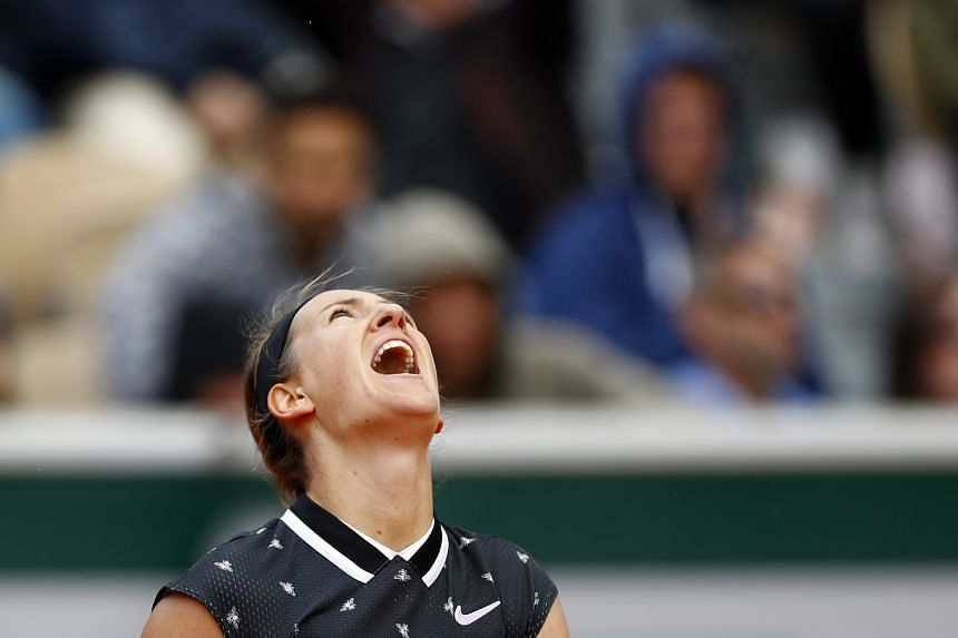 Azarenka celebrates after winning her first round match against Latvia's Jelena Ostapenko.