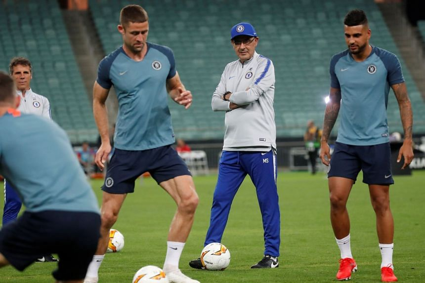 Chelsea manager Maurizio Sarri with Gary Cahill and Emerson Palmieri during training in Baku.