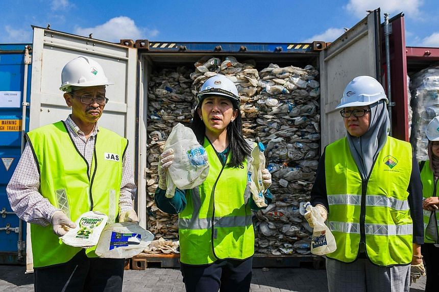Malaysia's environment minister Yeo Bee Yin (centre) showing samples of plastic waste from Australia yesterday.