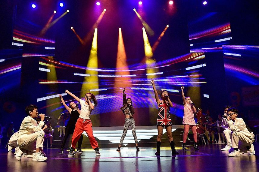 Performers singing Bring It All Back by S Club 7 at last year's ChildAid concert, which raised more than $2 million for ST's School Pocket Money Fund and BT's Budding Artists Fund.