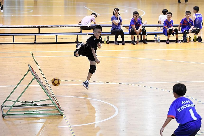 Junyuan Primary School's Grady Soon attempting a shot during the SPH Foundation National Primary School Tchoukball Championships senior boys' final against Alexandra Primary School at the Singapore Basketball Association in Aljunied yesterday. Junyua