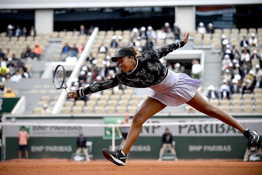 Top: Naomi Osaka stretching to hit a return to Anna Karolina Schmiedlova during their first-round match. The Japanese world No. 1 prevailed despite being served a bagel in the opening set. Above: Alexander Zverev pumping his fist after winning a poin