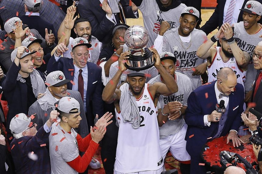 The Raptor's acquisition of forward Kawhi Leonard (holding the NBA Eastern Conference trophy) this season has been vindicated with Toronto now fighting to win their first NBA Finals in franchise history. PHOTO: REUTERS