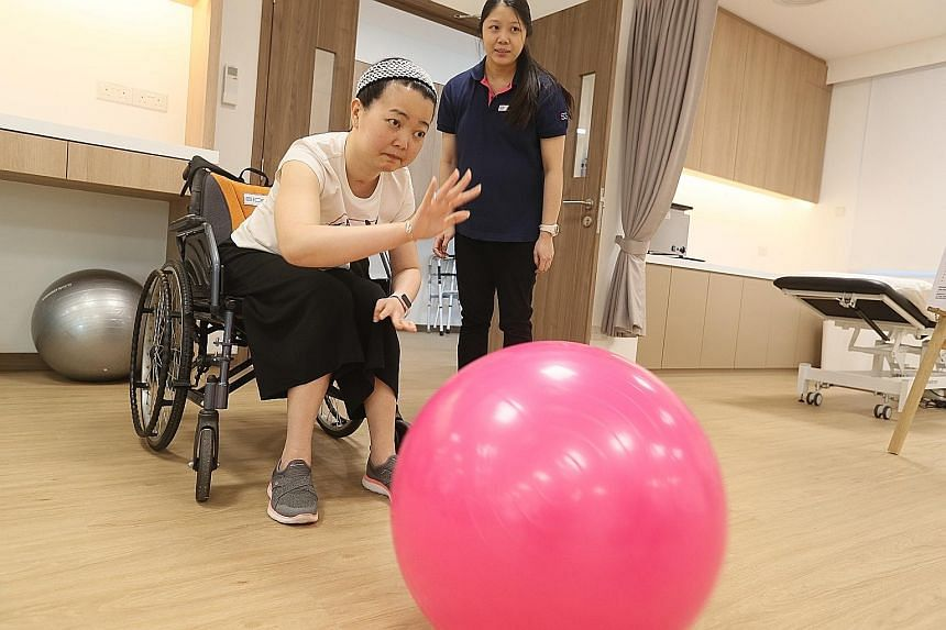 Stroke survivor Stephanie Lim, a participant of the Re-learn and Enjoy Active Living programme, going through a physical rehabilitation exercise at the new Stroke Wellness Centre in Jurong.