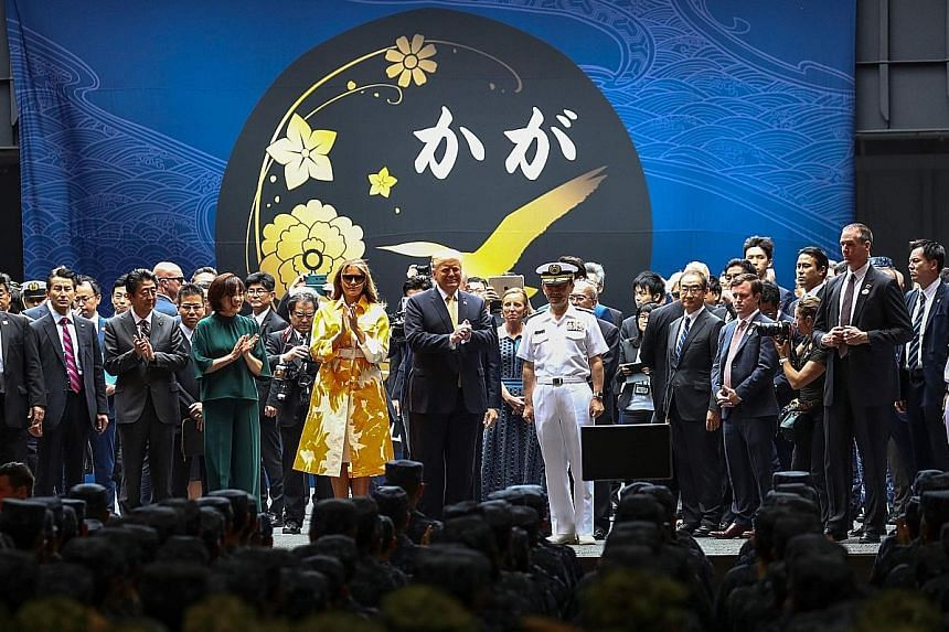 President Trump and his wife Melania with Japanese Prime Minister Shinzo Abe (second from left) and his wife Akie on board the Japanese warship JS Kaga at the Japanese Maritime Self-Defence Force base in Yokosuka yesterday. Mr Trump and his wife Mela