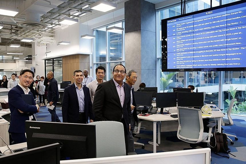 Communi-cations and Information Minister S. Iswaran visiting the revamped ST newsroom yesterday with (from right) SPH chairman Lee Boon Yang; EMTM head of digital strategy Eugene Leow; ST editor Warren Fernandez; and SPH deputy chief executive office