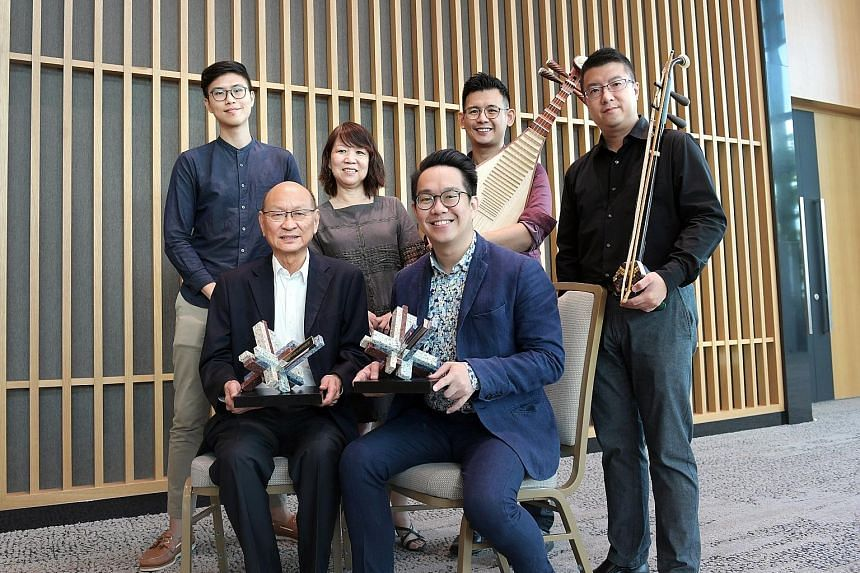 (Front row from far left) Historian Kua Bak Lim and Ding Yi Music Company's general manager and assistant conductor Dedric Wong. (Back row from far left) Ding Yi Music Company's marketing manager Tan Hong Ging, assistant general manager Sally Ng, pip
