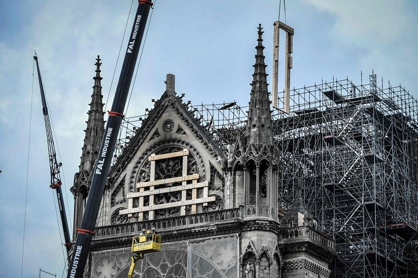 Repairs and renovations are under way at Notre Dame Cathedral in Paris. The landmark building lost its roof and spire in a huge fire last month, and an opinion poll shows that most respondents want the cathedral rebuilt exactly as it was before the d