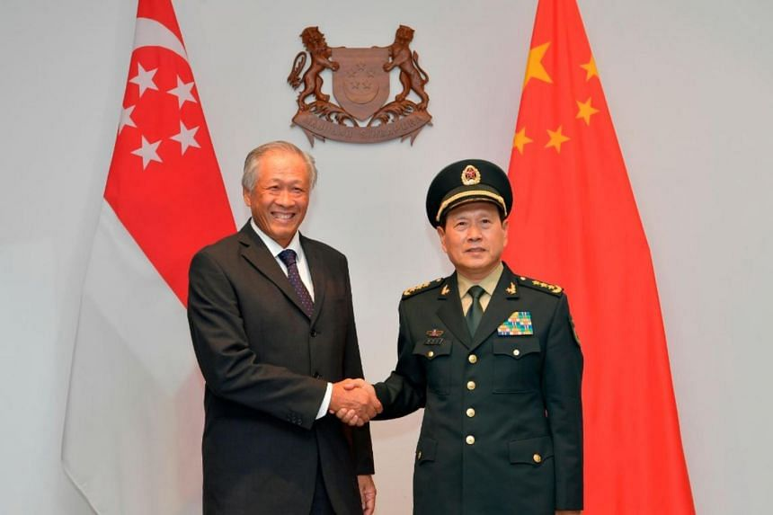 Defence Minister Ng Eng Hen (left) met China's Defence Minister Wei Fenghe on May 29, during which they agreed to revise a defence pact which could include larger-scale military exercises and frequent high-level dialogues, as part of efforts to dee