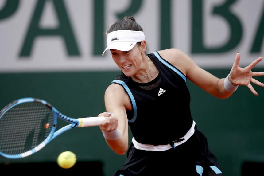 Spaniard Garbine Muguruza (above), who lifted the Suzanne Lenglen Cup in 2016, relied on her booming forehand throughout and wrapped it up when opponent Johanna Larsson netted a service return.
