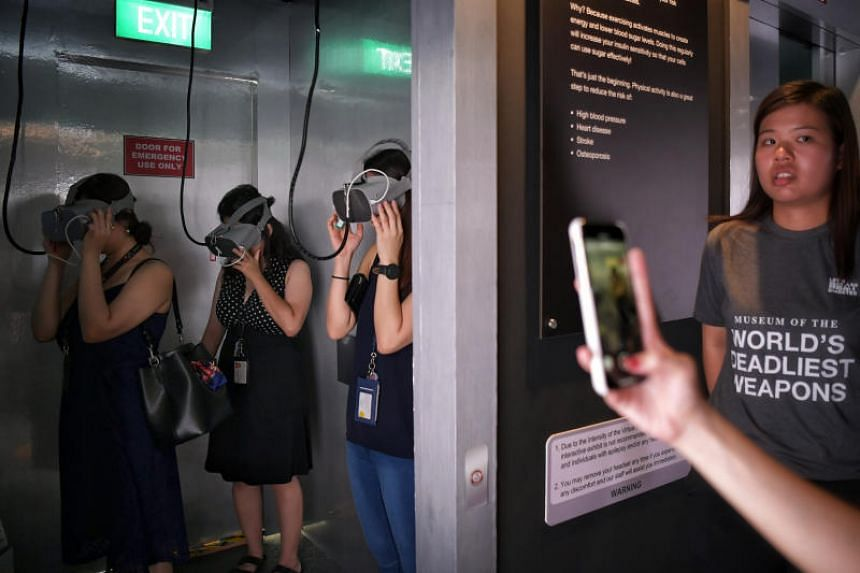 The Grim Lift exhibit makes use of virtual reality to give visitors a close encounter with the Grim Reaper in a lift to show the risk of early death associated with a lack of physical activity.
