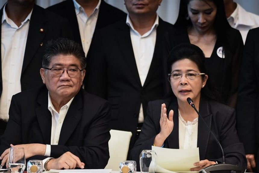 Pheu Thai party leader Sudarat Keyuraphan (right) speaks as secretary-general Phumtham Wechayachai looks on during a press conference in Bangkok on March 27, 2019.